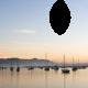 Boats at sunset momento card